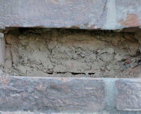Spouwmuurisolatie met Supafil na verwijderen puin