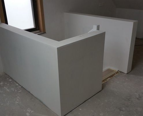 Vaste trap op maat met muurtje